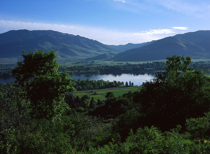 This is a beautiful picture in Ogden Valley with the Pineview Reservoir winding through the middle.  The lush green landscape is inviting and shows the majestic beauty of the Ogden Valley and of Utah.