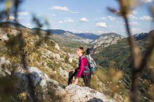 Lady Hiking on a Mountain